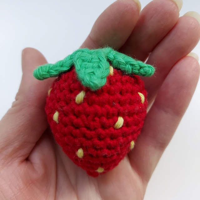 A cute crochet strawberry for a child's play kitchen