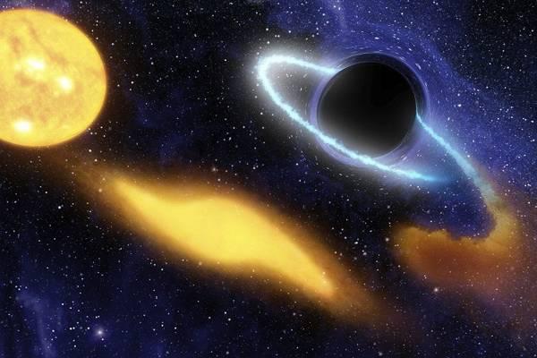 Un agujero negro absorbe a un astro. Imagen ilustrativa.