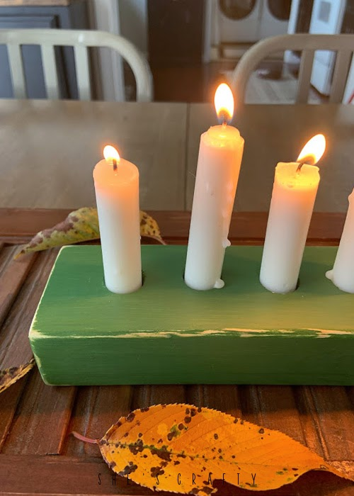 Wooden candle holder painted green