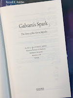 Galvani's Spark: The Story of the Nerve Impulse, by Alan McComas, superimposed on Intermediate Physics for Medicine and Biology.