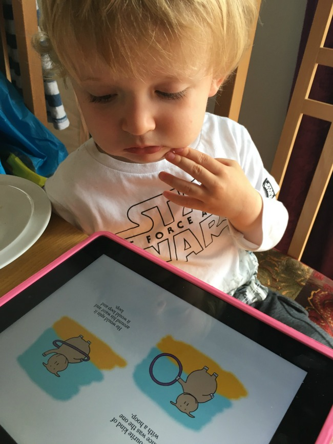 toddler-looking-at-ebook-on-ipad-the-hula-hooping-hippo