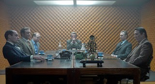 film still from Tinker Tailor Soldier Spy with a group of spies round a table looking tense