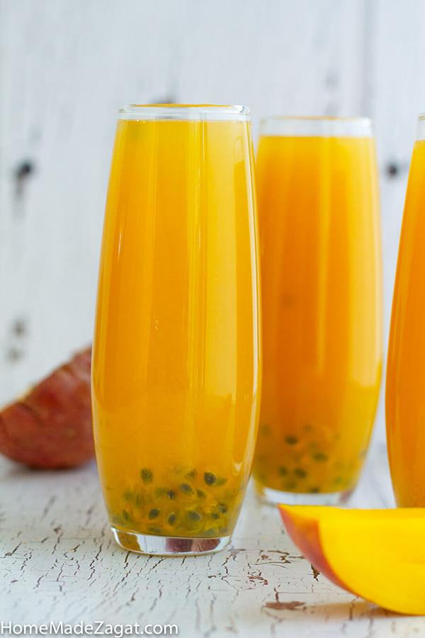 Glasses of mango passion fruit juice close up shot