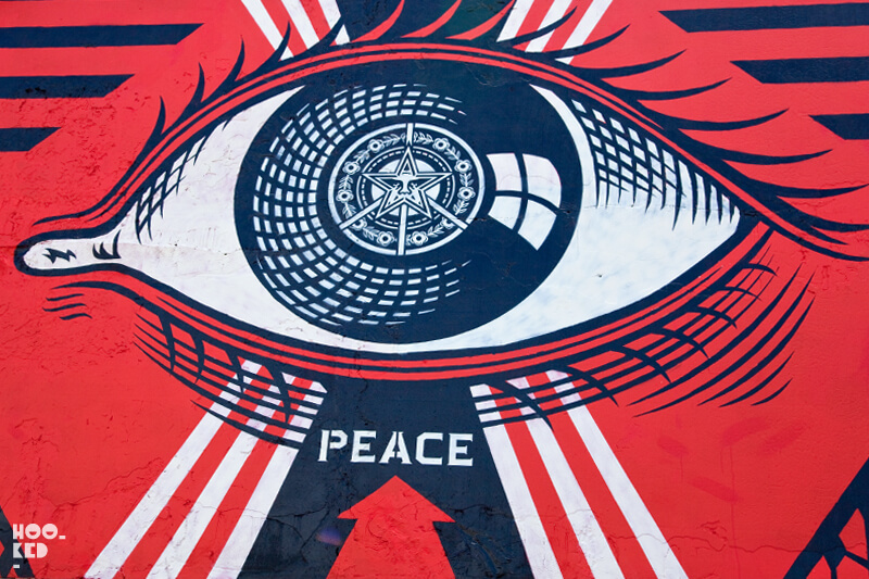 Street Artist Shepard Fairey installs North London Mural