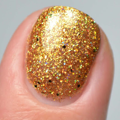 gold holographic glitter nail polish close up swatch