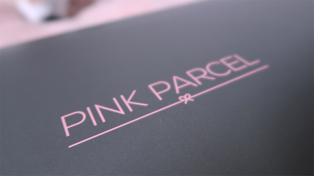 Pink parcel grey box with pink logo