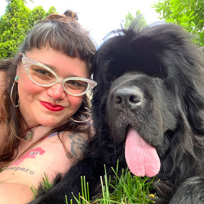 Interview with Sassafras Lowrey, pictured here with hir Newfoundland dog, Sirius, about hir latest book, Chew This Journal