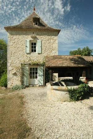 Charming #FrenchFarmhouse exterior facade with green shutters and #limestone