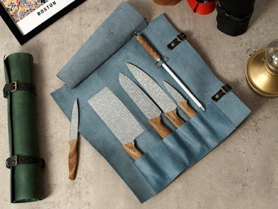 blue leather knife roll, unrolled