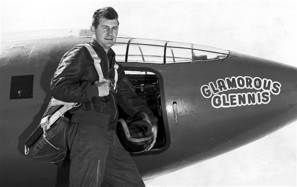 Chuck Yeager poses next to the Bell X-1 'Glamorous Glennis'...which he used to break the sound barrier on October 14, 1947.