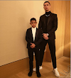 Cristiano Ronaldo and his son strike a pose in matching suits