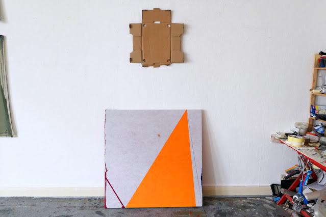 """Michel Carmantrand WATCHING MATCHINE: oil, black pencil and blue Bic pen on reversed inverted and cut out oilcloth, 100x100x4cm (40x40x1.6""""), 2021. Cardboard: unfolded cutout and stapled tangerines crate, 54x54cm (21x21""""), 2021."""