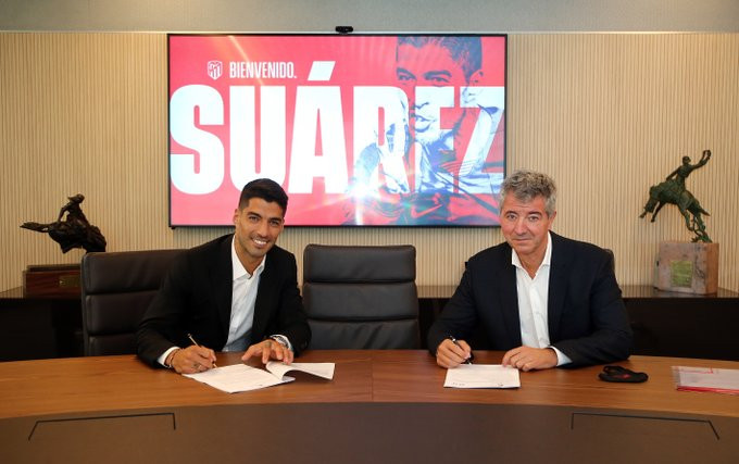 Atletico Madrid complete signing of striker Luis Suarez from Barcelona for only £5.5m