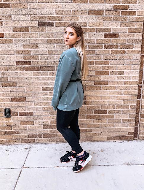 girl wearing acta activewear leggings and sweatshirt
