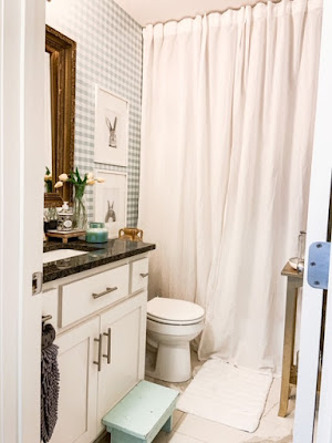 add character to a builder grade bathroom
