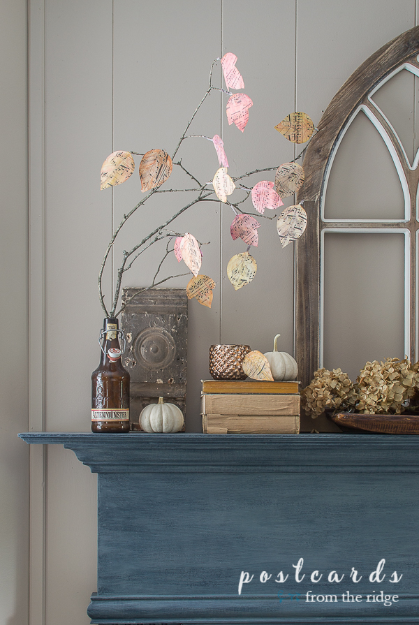 mantel decor with diy watercolor sheet music leaves and vintage items