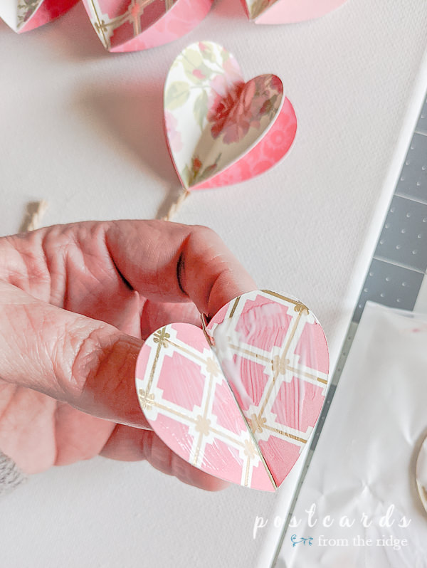 glue on the back of a 3-D paper heart