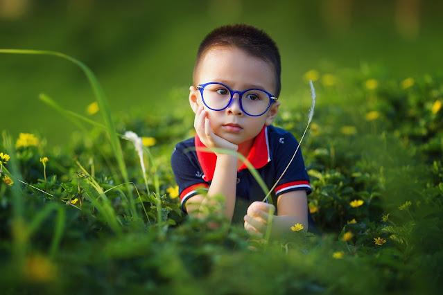 beautiful kid in grass, eyeglasses, child