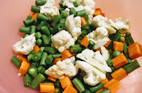 Chopped beans, carrots, cauliflower and green peas for veg (vegetable) biryani recipe