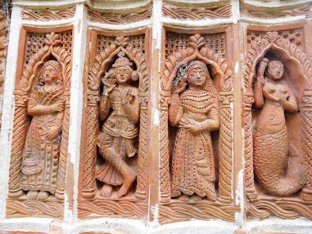 Krishna flanked by his principal wives - Rukmini and Satyabhama. Pratapeshwar Temple, Kalna Rajbari Temple complex, West Bengal