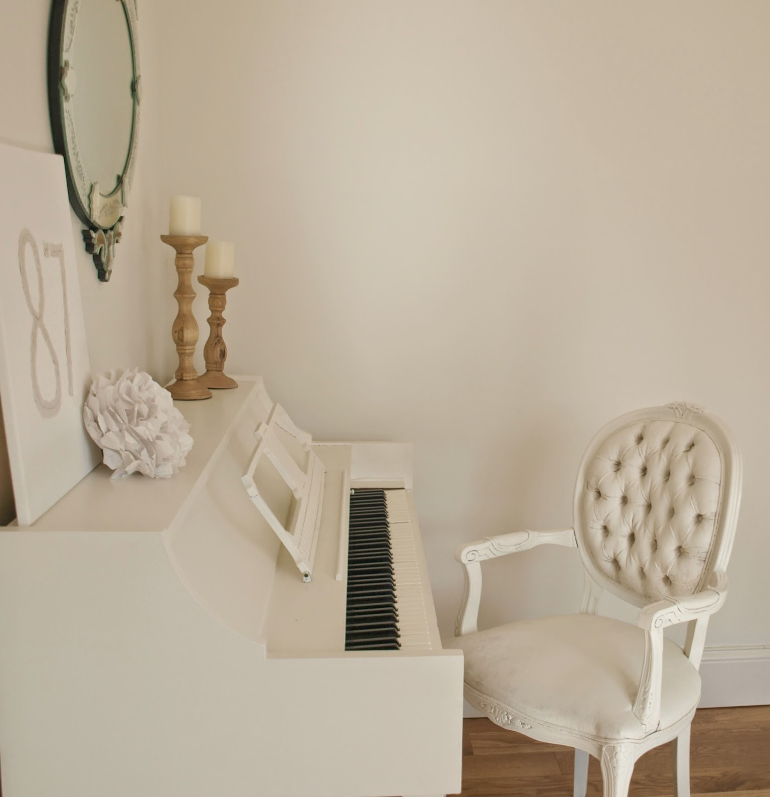 Hello Lovely Studio white piano and Louis chair