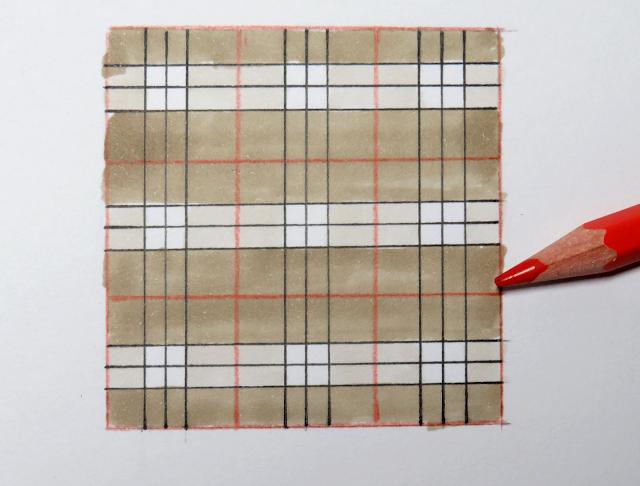 Trazo de líneas verticales y horizontales en los espacios con lápiz rojo
