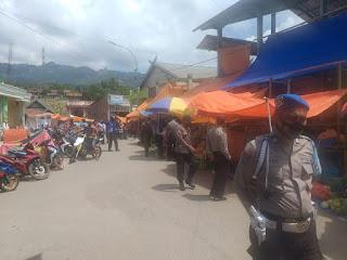 Tingkatkan Patroli Siang, Sat Sabhara Polsek Alla Menyisir Pasar Sudu Berikan Himbauan Cegah Covid-19