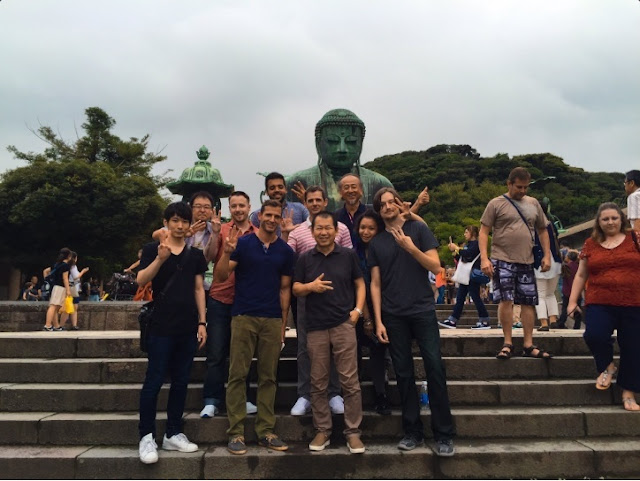Yu Suzuki with the Japanese Dinner reward backers at the Great Buddha in Kamakura.