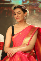 Kajal Aggarwal in Red Saree Sleeveless Black Blouse Choli at Santosham awards 2017 curtain raiser press meet 02.08.2017 028.JPG