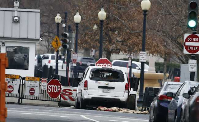 vehicle-hits-white-house-security-barrier-reuters