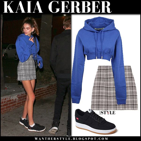 Kaia Gerber in blue cropped hoodie off-white, grey mini skirt and black sneakers nike model street style november 17 2017