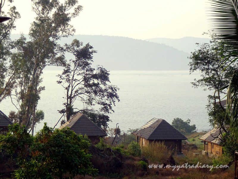 Cottages and beach seen from the MTDC Resort Harihareshwar, Maharashtra