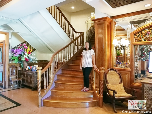 The grand staircase at the Legend Villas