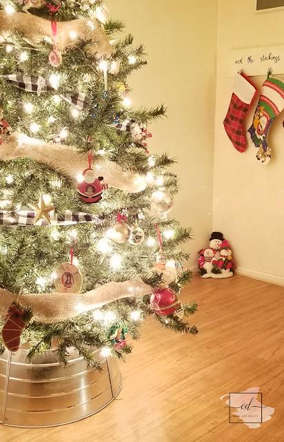 An inexpensive farmhouse Christmas tree makeover with a tree collar and buffalo plaid ribbon!     #farmhouse #christmas #homedecor #holiday