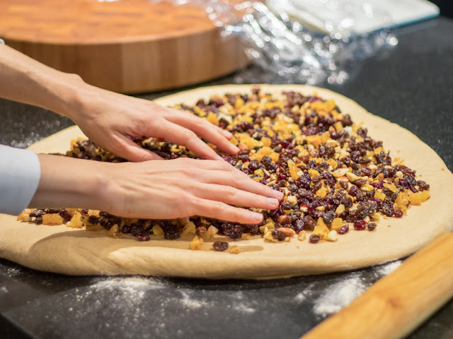 adding the fruit and nuts to stollen dough