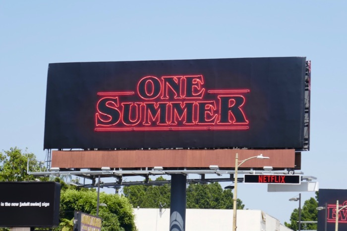 One Summer Stranger Things 3 neon sign billboard daytime