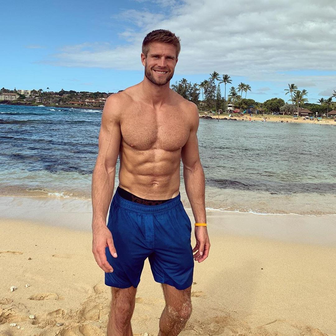 handsome-shirtless-blond-man-smiling-beach-blue-shorts-hairy-barechest-hunk