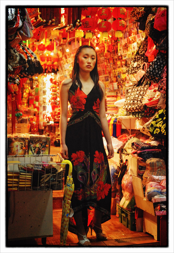 Chinese gift shop at night, red lanterns, full length fashion portrait, Sunny - Chinatown 2007 New Edition, Photographed by Kent Johnson