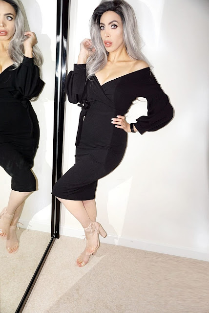 Influencer Savana Rae wearing the Black Belted Bodycon Midi Wrap Dress - Angelica from Femme Luxe Finery