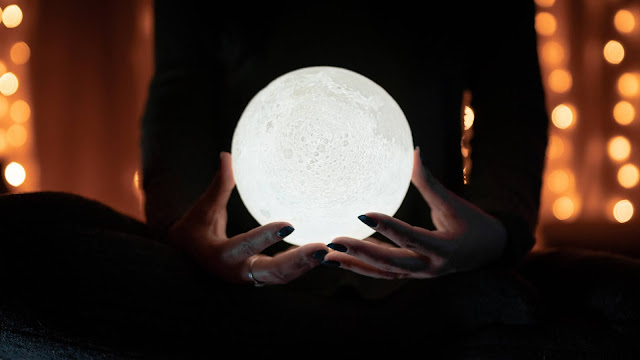Picture of a woman holding a moon