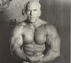 Superstar Billy Graham flexing like there's no tomorrow.