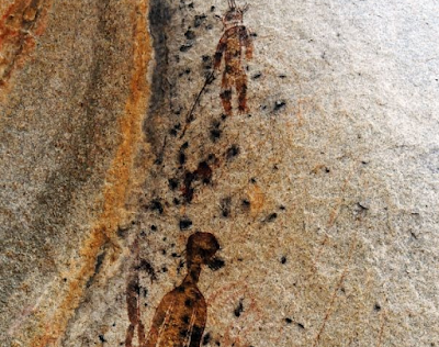 Alien in Indian cave painting.