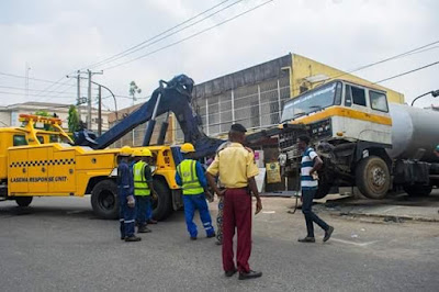 Photos car collides with container truck on adeniyi jones for Jones motor company trucking