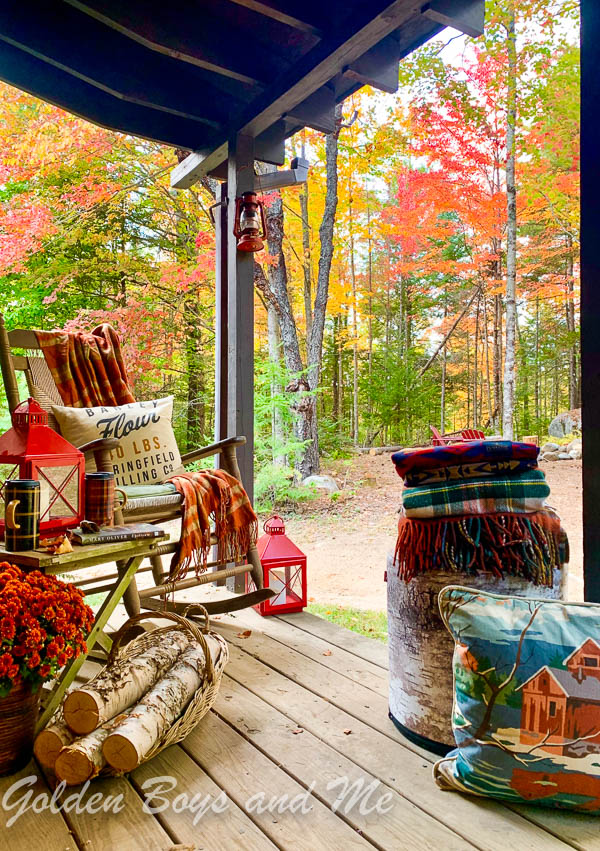 Porch with rustic fall decor at a mountain cabin with fall foliage. - www.goldenboysandme.com