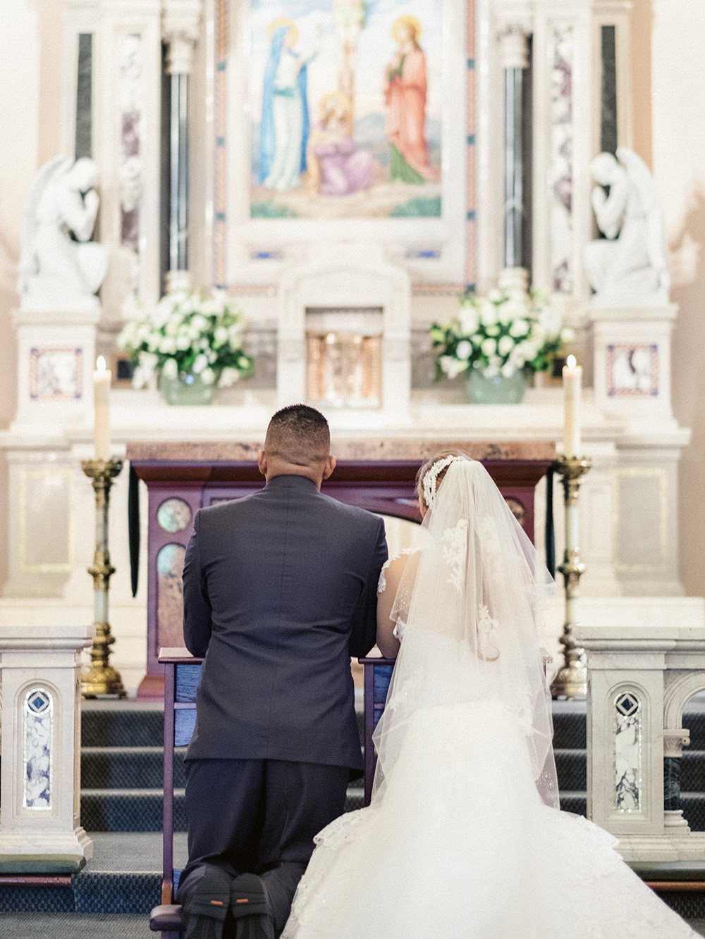 knee in front of god, wedding at St. Vincent de Paul Church