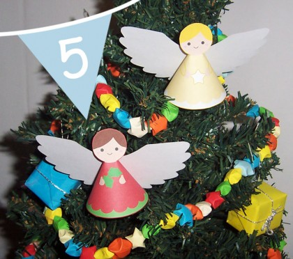 http://handmadecuddles.com/2011/12/christmas-tutorial-advent-paper-angel-printable.html