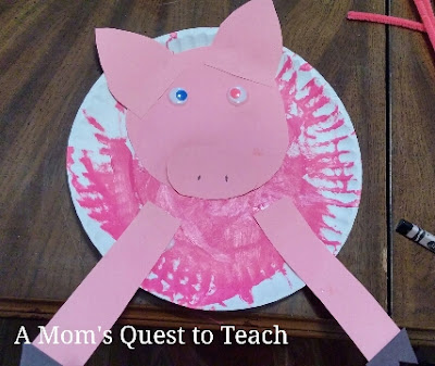 completing paper plate pig craft