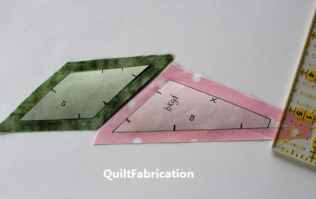 green and pink fabrics with freezer paper templates ironed on