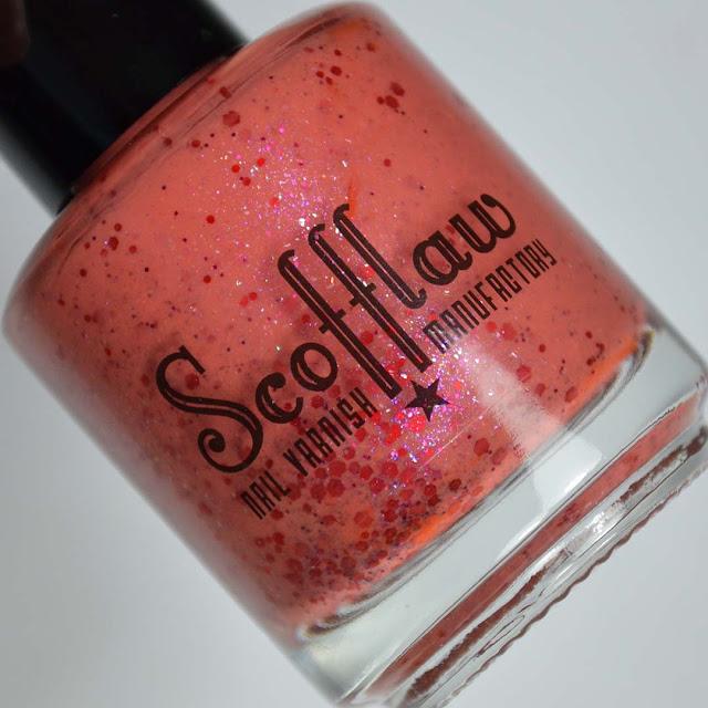 orange nail polish with red glitter