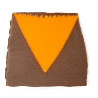 A slanted square dark brown to black piece of soap with a triangular orange shape in the middle on a bright background